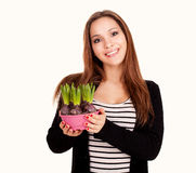 Beautiful young woman with flowers in pot Stock Photography