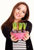 Beautiful young woman with flowers in pot Royalty Free Stock Image