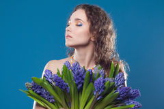 Beautiful young woman with flowers Royalty Free Stock Photos