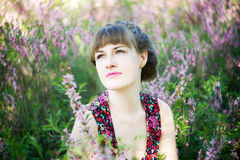 Beautiful young woman with flowers. Beautiful young woman with spring purple flowers Stock Photography