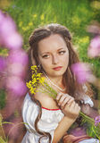 Beautiful young woman with flowers Stock Photo