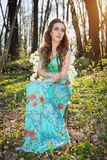 Beautiful young woman with flowers in the woods Stock Image