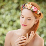 Beautiful young woman with flowers wreath in hair Royalty Free Stock Photo