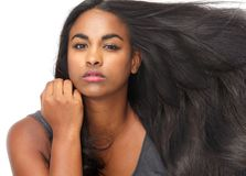 Beautiful young woman with flowing hair Stock Images