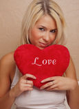 Beautiful young woman with fluffy heart Stock Image