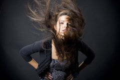 Beautiful young woman with flying hair Stock Image
