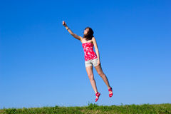 Beautiful young woman is flying up Stock Photography