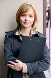 Beautiful young woman with folder Stock Photography