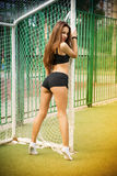 Beautiful young woman on the football field Stock Photos