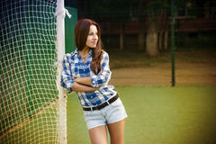 Beautiful young woman on the football field Stock Photography