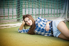 Beautiful young woman on the football field Royalty Free Stock Photo