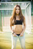 Beautiful young woman on the football field Royalty Free Stock Images