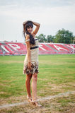 Beautiful young woman on the football field Royalty Free Stock Image