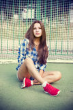 Beautiful young woman on the football field Stock Image
