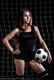 Beautiful young woman with a football Royalty Free Stock Photography