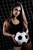 Beautiful young woman with a football Stock Image