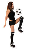 Beautiful young woman with a football Royalty Free Stock Image
