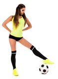 Beautiful young woman with a football stock photography