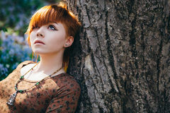 Beautiful young woman in the forest Stock Photo