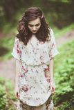 Beautiful young woman in the forest Stock Image