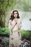 Beautiful young woman in the forest Stock Images