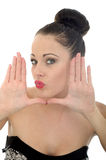 Beautiful Young Woman Framing Her Face With Her Hands Looking Ha Royalty Free Stock Photography