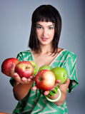 Beautiful young woman with fresh apple Royalty Free Stock Image