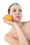 Beautiful Young Woman with Fresh Clean Skin and peach Royalty Free Stock Image