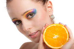 Beautiful young woman with fresh orange. Stock Photo