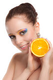 Beautiful young woman with fresh orange. Royalty Free Stock Images