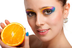 Beautiful young woman with fresh orange. Royalty Free Stock Image