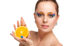 Beautiful young woman with fresh orange. Stock Photography