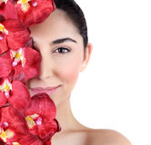 Woman with orchid flowers on face Royalty Free Stock Photography