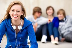 Beautiful young woman with friends Royalty Free Stock Photos