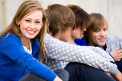 Beautiful young woman with friends Royalty Free Stock Photography