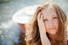 Beautiful young woman in front of the boat stock photography