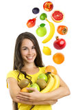 Beautiful young woman with fruits Royalty Free Stock Images