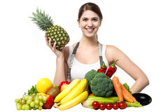 Beautiful young woman with fruits and vegetables Stock Photo