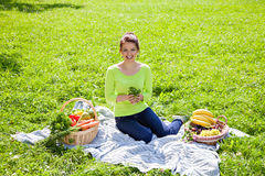 Beautiful young woman with fruits and vegetables Royalty Free Stock Images