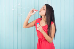 Beautiful young woman funny blowing party bubbles Stock Photos