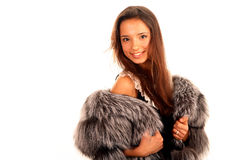 Beautiful young woman in fur coat Royalty Free Stock Photo