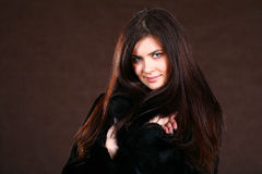 Beautiful Young Woman In A Fur Coat. Royalty Free Stock Photos