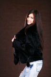 Beautiful Young Woman In A Fur Coat. Royalty Free Stock Photography
