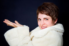 Beautiful young woman in a fur coat Stock Images