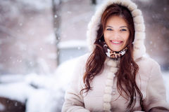 Beautiful young woman in a fur coat Stock Photography