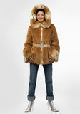 Beautiful young woman in a fur coat. Stock Photography