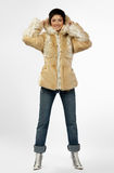 Beautiful young woman in a fur coat. Stock Photos
