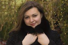 Beautiful young woman in a fur coat closeup Royalty Free Stock Photography
