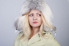 Beautiful young woman in fur hat Royalty Free Stock Image