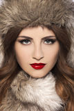 Beautiful young woman with fur hat. Stock Photo